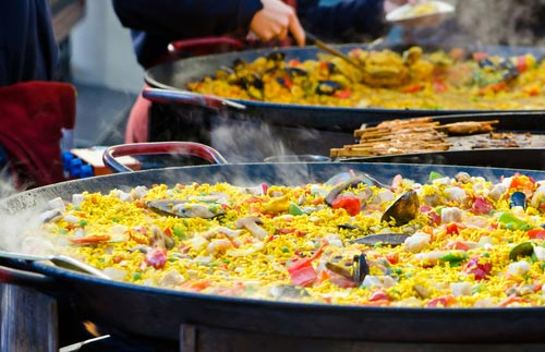two paellas been cooking outside