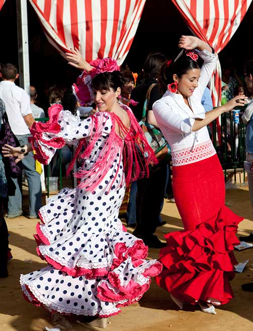 Two Seville's girls dancing sevillanas in the April's Fair