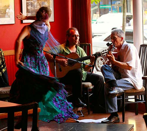 A Flamenco dancer together with to guitarists